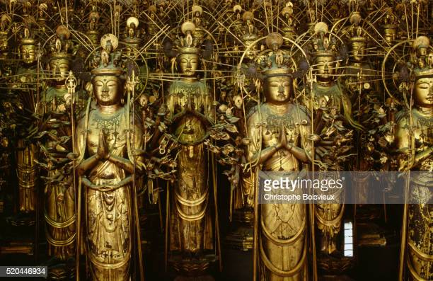 statues of goddess kannon at sanjusangendo temple - guanyin bodhisattva stock pictures, royalty-free photos & images