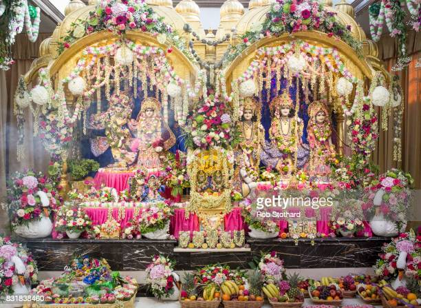 Statues of Hindu deities and offerings of food are seen in the temple at Bhaktivedanta Manor during the Krishna Janmashtami festival on August 14...