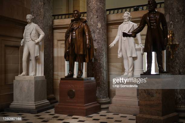 Statues of Jefferson Finis Davis , president of the Confederate States from 1861-1865, and Uriah M. Rose , an Arkansas county judge and supporter of...