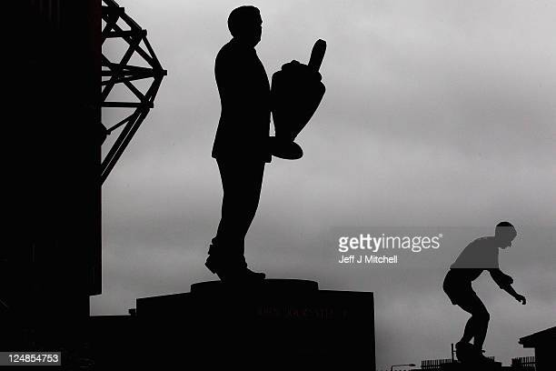 Statues of Jock Stein and Jimmy Johnstone stand outside Celtic Park on September 13 2011 in Glasgow Scotland Celtic will now face Atletico Madrid in...