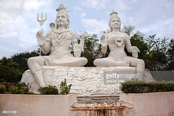 statues of lord shiva and goddess parvathi, kailasagiri park, visakhapatnam, andhra pradesh, india - kailasagiri park stock pictures, royalty-free photos & images