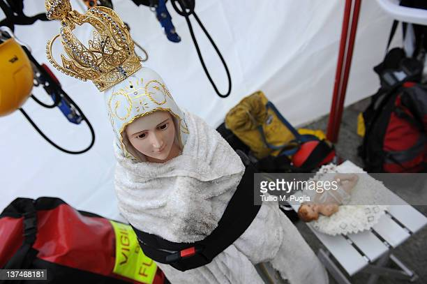Statues of Madonna and Jesus are kept by firefighters in storage after they were recovered from a chapel onboard the Cruise ship Costa Concordia as...