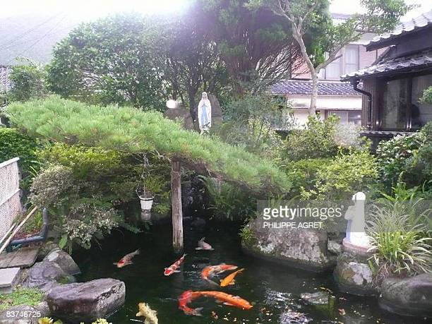 STORY JAPANRELIGIONHISTORYCHRISTIANITY BY KIMIKO DE FREYTASTAMURA Statues of Madonna stand in a Japanese garden of a local resident in Fukue island...