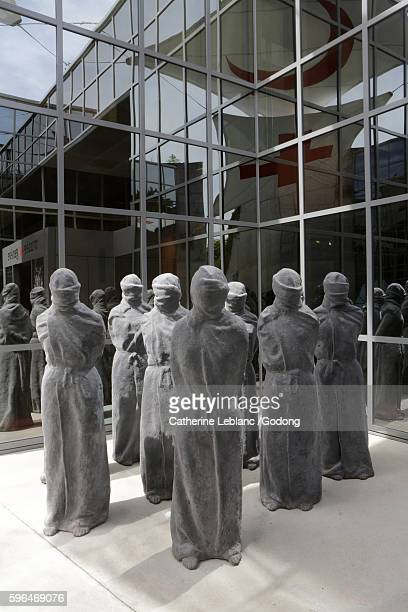 statues of prisoners in stone. international red cross and red crescent museum. cicr. geneva. switzerland. - philanthropist stock pictures, royalty-free photos & images
