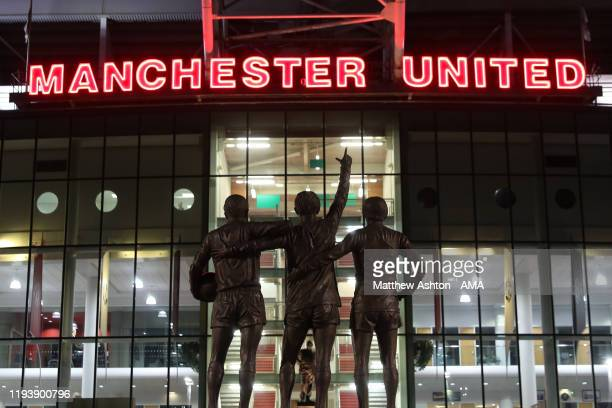 Statues of Sir Bobby Charlton George Best and Denis Law outside Old Trafford before the FA Cup Third Round Replay match between Manchester United and...