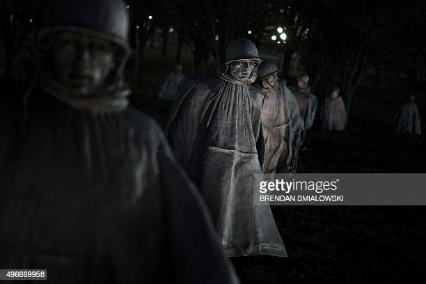 Statues of soldiers are seen at the Korean War Memorial on the National Mall on Veterans Day November 11 2015 in Washington DC AFP PHOTO/BRENDAN...