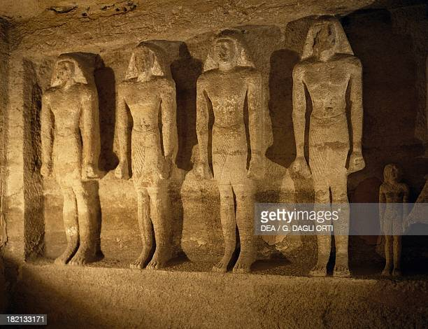 Statues of the deceased aligned in the burial chamber Mastaba of Qar Giza Necropolis Egyptian Civilisation Old Kingdom Dynasty VI