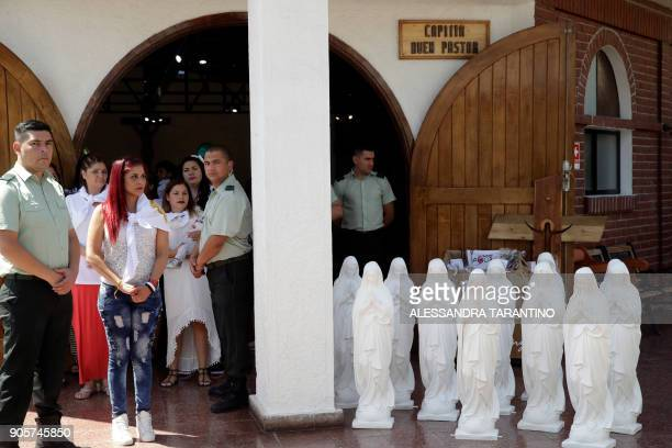 Statues of the Virgin Mary to be blessed by the pontiff stand next to a group of inmates and guards who await for Pope Francis' arrival at San...