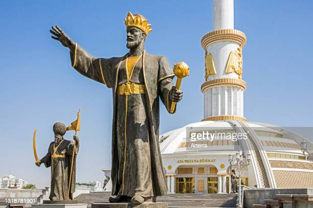 Statues of Turkmen leaders in front of the Independence Monument, built for the independence from the Soviet Union in 1991, Ashgabat, Turkmenistan.