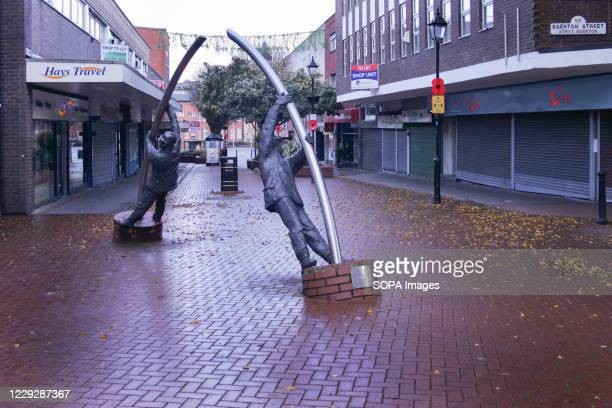 Statues of two miners symbolising the towns industrial past are pictured on a deserted street on the first Sunday of Wales' national lockdown.