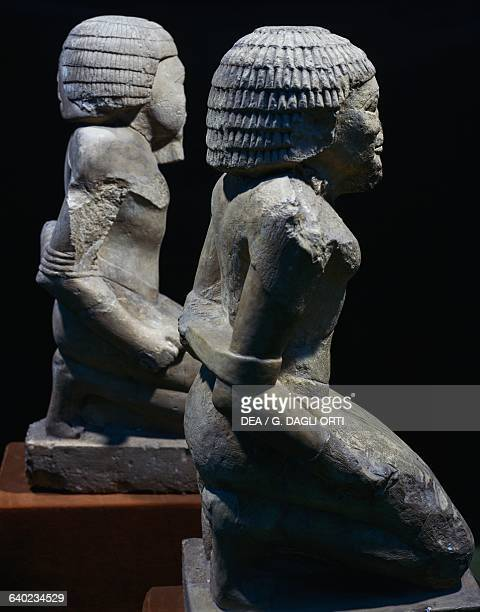 Statues of two prisoners from the funerary temple of Pepi I at Saqqara Egyptian civilisation Dynasty VI Cairo Egyptian Museum