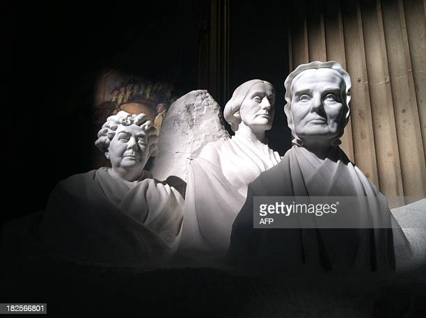 Statues of US pioneers for women's suffrage Elizabeth Cady Stanton Susan B Anthony and Lucretia Mott are seen Septembder 30 2013 in the US Capitol...