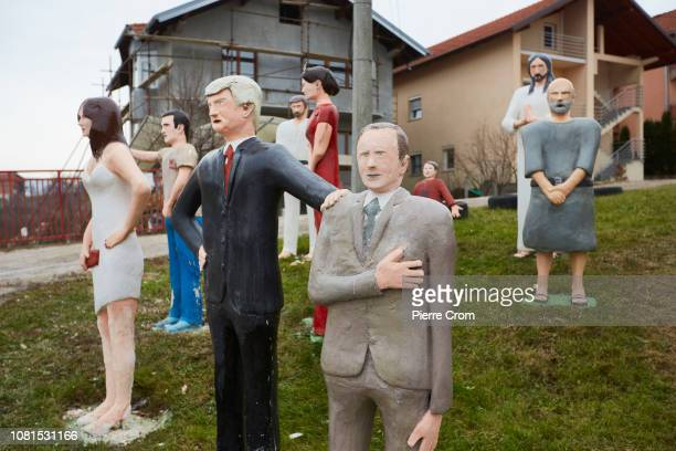 Statues of US president Donald Trump holding on the shoulder of president of Russia Vladimir Putin made by Bosnian Serb artist Stevo Selak are on...