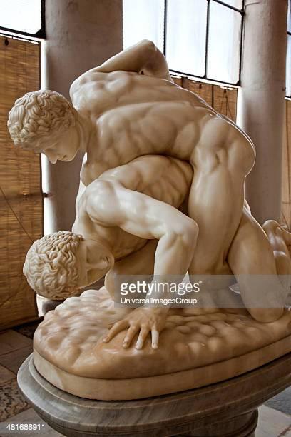 Statues of wrestling men Chowmahalla Palace Hyderabad Andhra Pradesh India