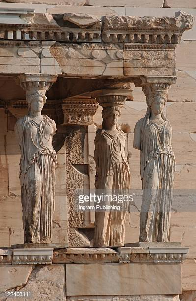 Statues on an ancient historical building in Athens, Greece