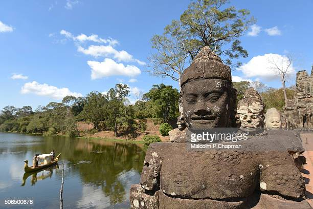 statues on bridge at angkor thom south gate, towards the bayon temple, siem reap, cambodia - angkor stock photos and pictures