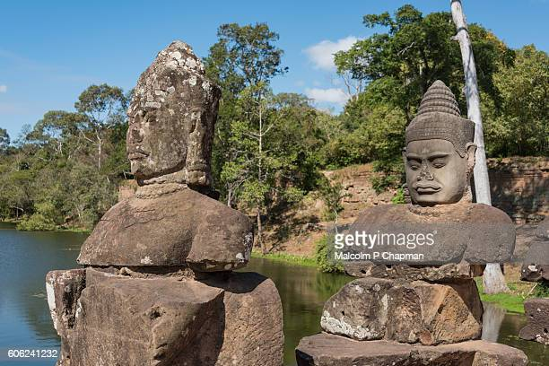 "statues on bridge at angkor thom south gate, towards the bayon temple, siem reap, cambodia - cambodia ""malcolm p chapman"" or ""malcolm chapman"" stock pictures, royalty-free photos & images"