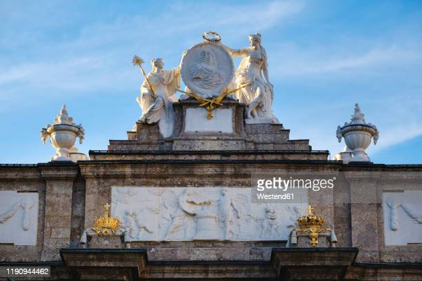 statues on triumphal arch against sky at innsbruck, austria - innsbruck stock pictures, royalty-free photos & images