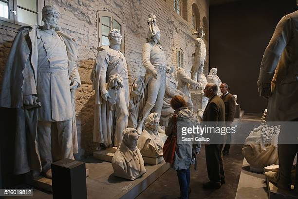 Statues that once stood at locations across the city stand on display at the exhibition 'Uncovered Berlin and its Monuments' at the Spandau citadel...