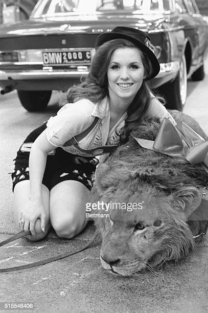Statuesque model Nell Theobald poses April 8 with Ludwig a lion during a promotion session inside the New York Coliseum for an automobile...