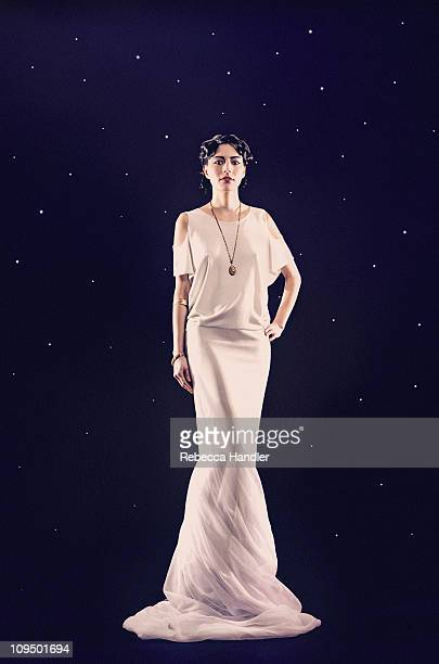 Statuesque woman in long dress