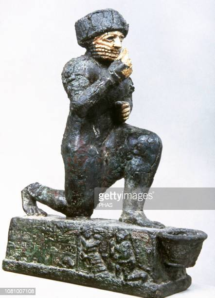 Statuette of a kneeling man known as The Worshipper of Larsa Dedicated by an inhabitant of Larsa to the god Amurru for the life of Hammurabi Bronze...
