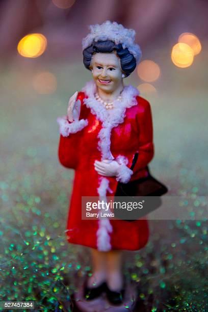 Statuette of Queen Elizabeth II in a shop window in London UK