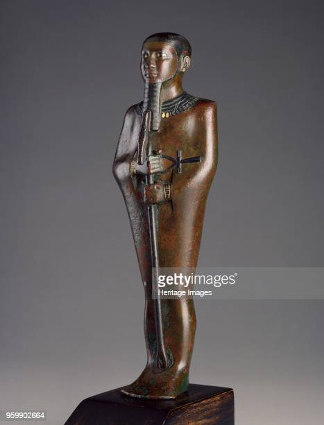 Statuette XXVIth Dynasty c664525BC Statuette the God Ptah standing mummiform holding sceptre bronze with niello and fragmentary gold inlays...