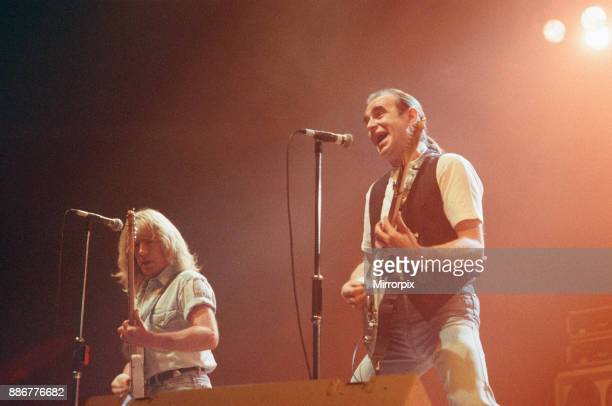 Status Quo in concert at the NEC in Birmingham, 11th December 1990. Our Picture Shows Rick Parfitt and Francis Rossi.