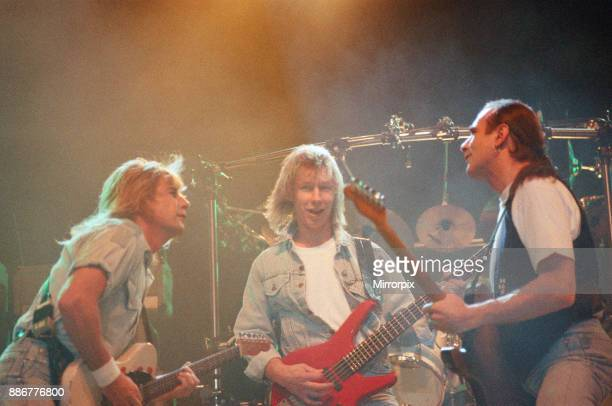 Status Quo in concert at the NEC in Birmingham, 11th December 1990. Our Picture Shows Rick Parfitt, John Edwards and Francis Rossi.