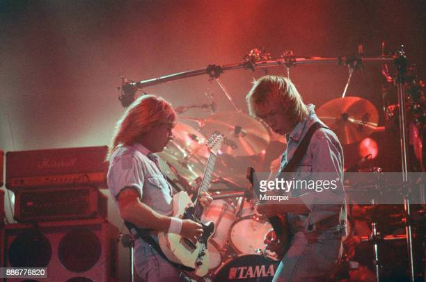 Status Quo in concert at the NEC in Birmingham 11th December 1990 Our Picture Shows Rick Parfitt and John Edwards