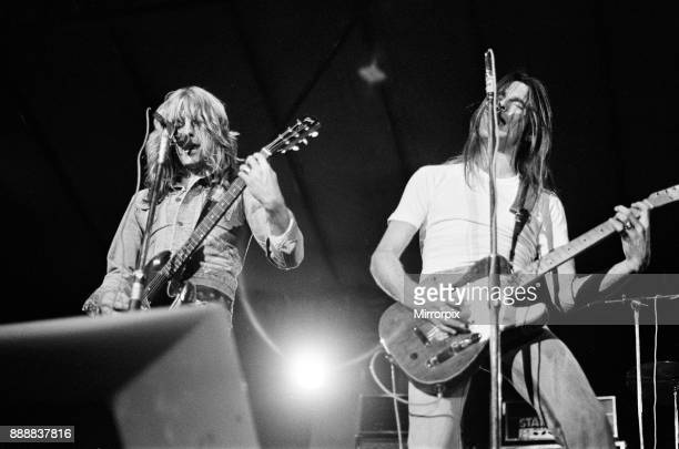 Status Quo perform at The Reading Festival on Saturday 25th August 1973 Picture shows Rick Parfitt and Francis Rossi The festival was then called The...