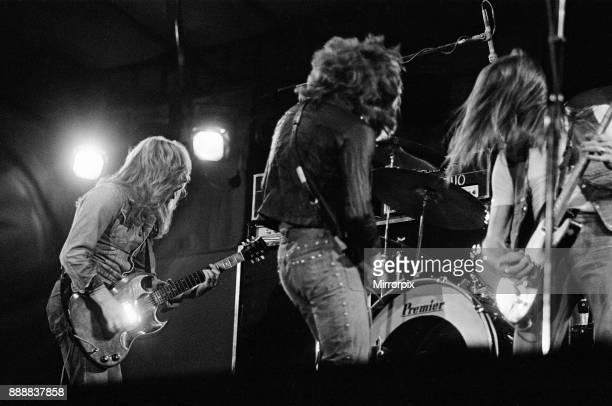 Status Quo perform at The Reading Festival on Saturday 25th August 1973 Picture shows Rick Parfitt Alan Lancaster and Francis Rossi The festival was...