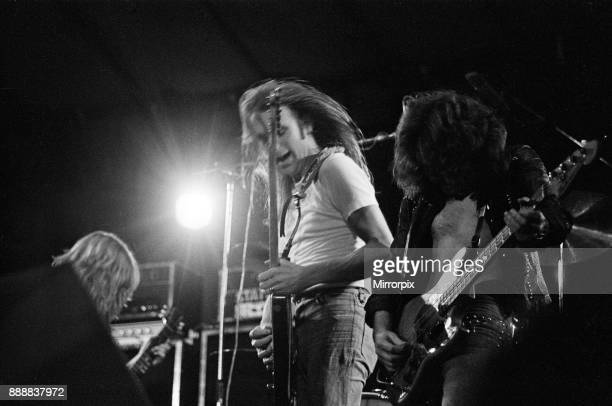 Status Quo perform at The Reading Festival on Saturday 25th August 1973. Picture shows Rick Parfitt and Francis Rossi and bass player Alan Lancaster...