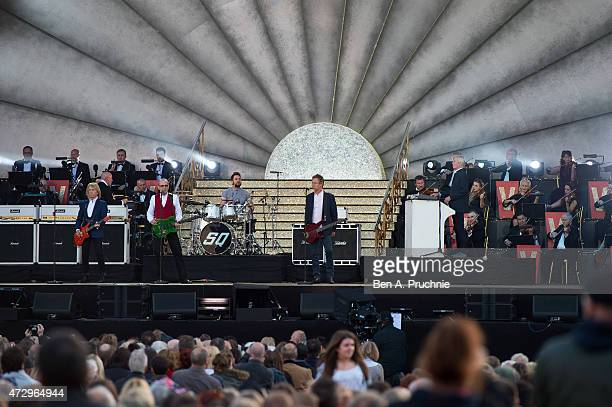 Status Quo performs during a concert on the 70th anniversary of VE Day at Horse Guards Parade on May 9 2015 in London England