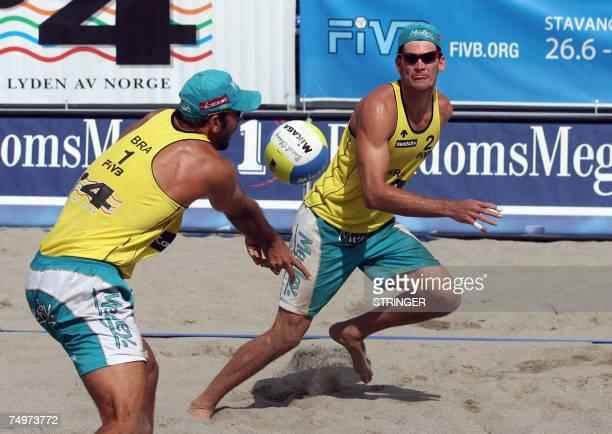 Brazil's winners Fabio Luiz and Marcio Araujo are seen during the Grand Slam Beach Volleyball tournament finals against Dutch Richard Schuil and...