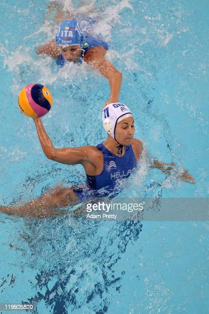Stavroula Antonakou of Greece is challenged by Giulia Rambaldi Guidasci of Italy in the Women's Water Polo semi final match between Greece and Italy...