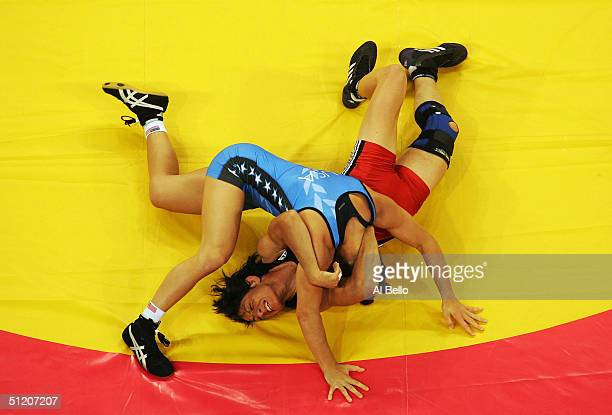 Stavroula Zygouri of Greece is pinned by Sara McMann of the USA during the women's Freestyle wrestling 63 kg qualification round on August 23, 2004...