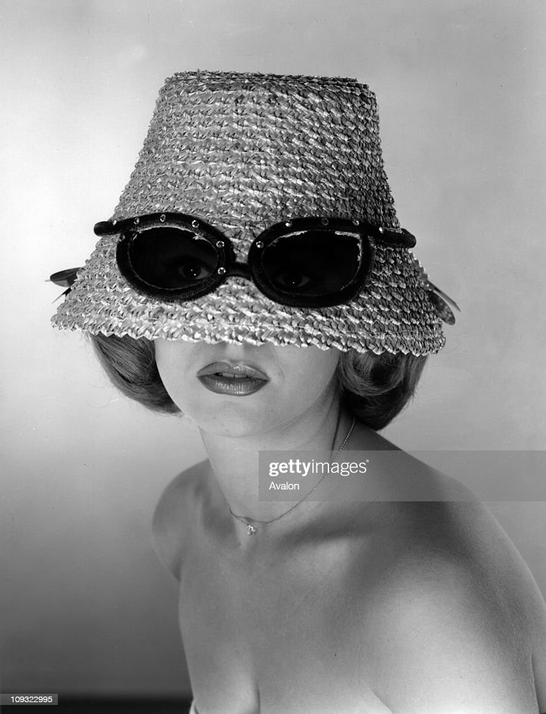 Staw hat designed with built in sunglasses,   News Photo
