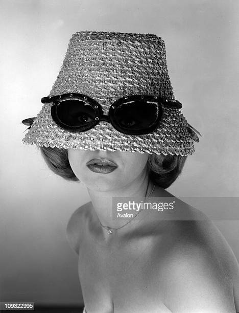 Staw hat designed with built in sunglasses