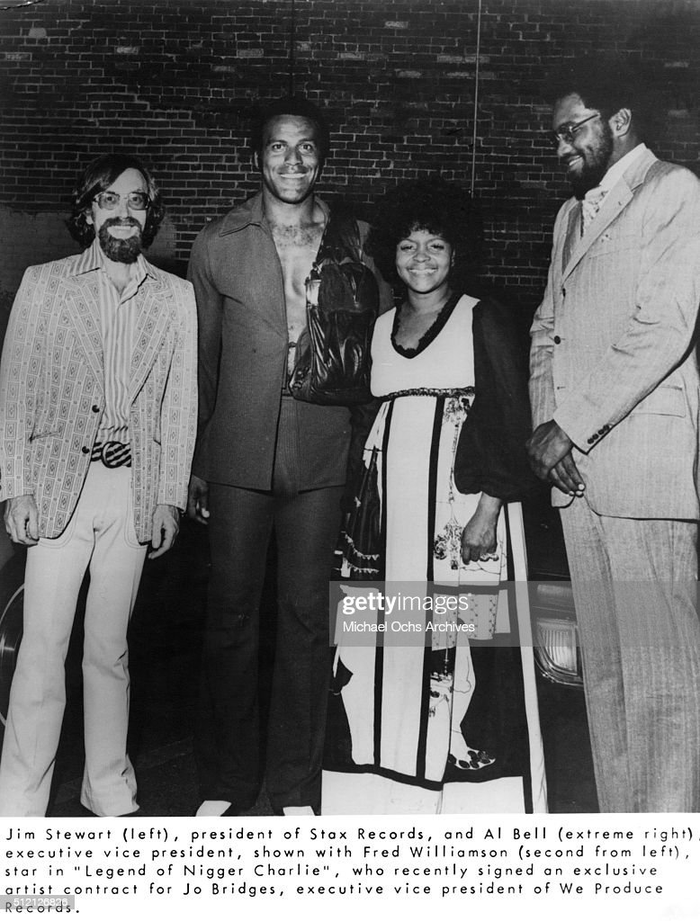 Stax Records president Jim Stewart, actor Fred Williamson, executive VP of We Produce Records Jo Bridges and Al Bell of Stax Records pose for a portrait after Willamson signed an exclusive deal with We Produce in circa 1977.
