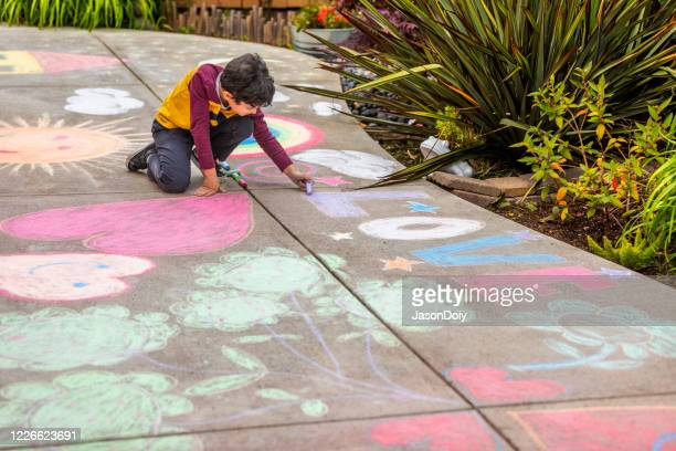 stay at home chalk drawing on sidewalk - chalk art equipment stock pictures, royalty-free photos & images