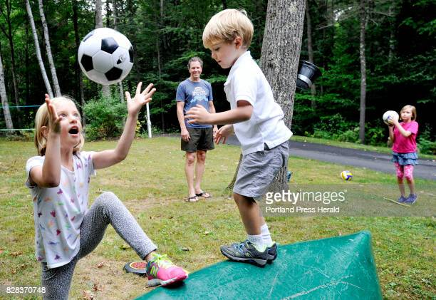 Stay at home dad Peter Hubbard watches his children as they play in the yard after school Friday September 23 2016 L to R Claire Peter Park and Iris 9