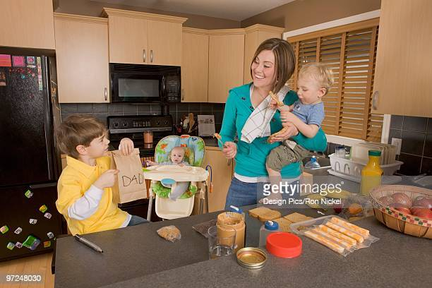 stay at home mom with her kids - stay at home mother stock-fotos und bilder