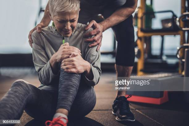 stay down, i will help you with your injured knee! - sprain stock pictures, royalty-free photos & images