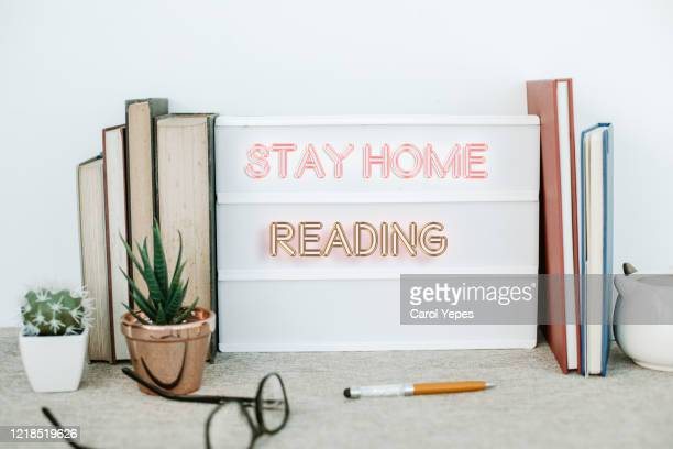 stay home and reading time message - science photo library stock pictures, royalty-free photos & images