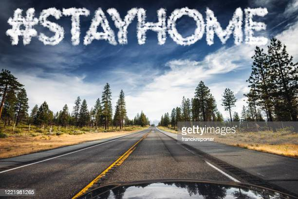 stay home concept sign on the sky - government shutdown stock pictures, royalty-free photos & images