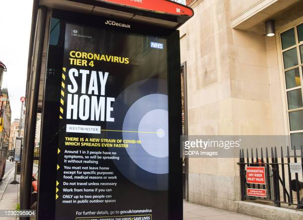 Stay Home' coronavirus sign on Charing Cross Road. London has been placed under Tier 4 restrictions as cases surge and new strains of COVID-19 emerge...