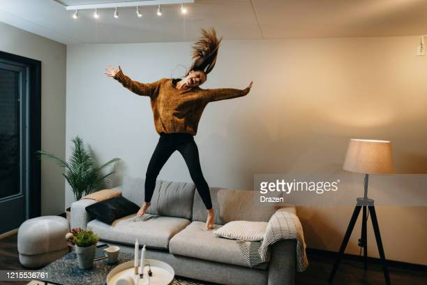 stay home during pandemic - dancing and physical activity - jumping stock pictures, royalty-free photos & images