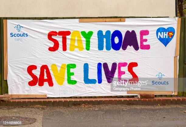Stay Home Save Lives, Scouts handmade sign, Woodbridge, Suffolk, England, UK.